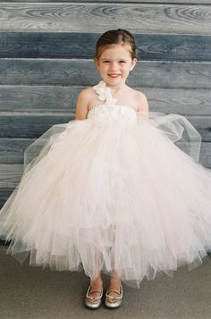 This flower girl is as cute as a button.
