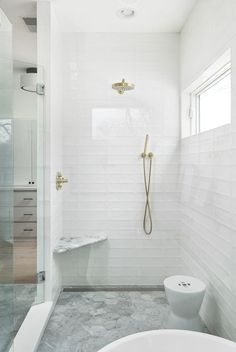 Bathroom tile Bathroom tiles are carrara 6 hex tiles on floor with a linear drain Subway long subway tiles have been stacked for a modern look These are glossy white with a wavy texture Bathroom tile Bathroom tiles are carrara 6 White Glass Tile, White Bathroom Tiles, Bathroom Renos, White Tiles, Bathroom Flooring, Modern Bathroom, Small Bathroom, Bathroom Showers, Bathroom Ideas
