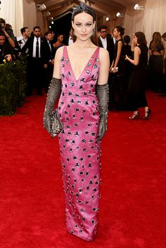Olivia Wilde in a plunging embroidered pink Prada gown and sleek gloves at the 2015 Met Gala