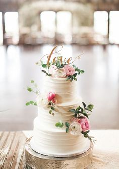 Love is all we need. And flowers. And a beautiful cake. Photo by Emilie Anne. | http://mysweetengagement.com/galleries/wedding-cakes/