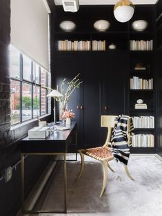 Black home office with built-in cabinetry and gold accents on Thou Swell @thouswellblog