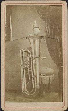 ca. 1860s, [composite carte de visite of a young man peering up from his tuba], M.C. Ragsdalevia the A.S. Williams III Americana Collection, University Libraries Division of Special Collections, The University of Alabama