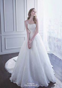This sweet white gown from Marie & Barbie featuring floral lace detailing is enchanting us with angelic romance!