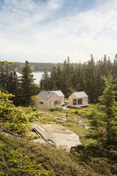 A trio of tiny cabins sits among jumbled chunks of broken granite on Vinalhaven, an island in Maine's Penobscot Bay. The site was once a quarry but vegetation is slowly growing back, returnin… Logic Design, Tiny Cabins, Cabins In The Woods, House And Home Magazine, Little Houses, Tiny Houses, Prefab, Home Design, Construction