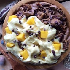 Mango + Chocolate Banana Ice Cream Quickly whipped up this bowl of 7 frozen bananas blended with a mango and carob powder