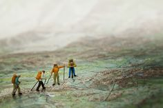 Some of the photos in this series make me giggle. Thought you'd like the little people hiking on the map!