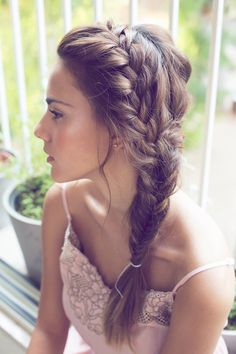 "A perfect ""didn't try too much"" hairstyle: A messy side-plait with fishtail"