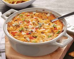 Cheesy Buffalo Chicken Dip | Cheesy Buffalo Chicken Dip Recipe - For game days or family gatherings, this make-ahead dip is robust and spicy and can feed even the heartiest of appetites. #Schwans #EasyRecipes #Inspiration