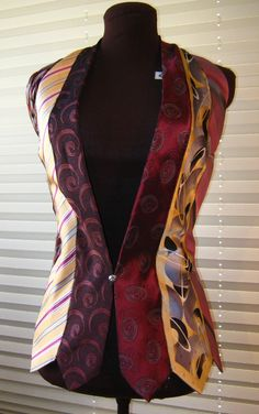 What could be snazzier? Make an artistic statement in this vest made entirely out of mens neckties! Accented with one of my Grandmas vintage buttons, this halter design is sure to turn heads. The back ties make it adjustable from small to medium. Dry clean only.