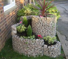 www.caras-ornamentals.com has just started developing Gabion Planters for domestic use...but they are in England!  Anyone know of a place closer to California???