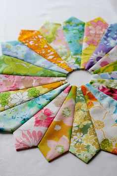vintage floral sheets. I have seen this done with old ties also!