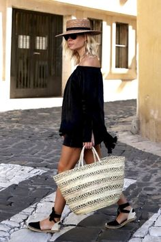 Photo via: We The People Jessie Bush put together a genius vacation-ready look and we want in! Here she is in a straw hat, sunglasses, black off-the-shoulder top, black denim skirt, woven tote and d'o