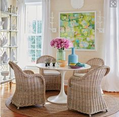 The Tulip Table and the Wicker Chair, the Perfect Pair for Spring!