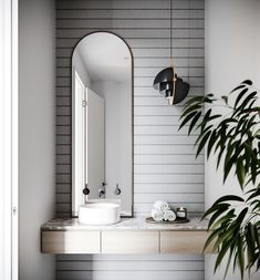 Modern bathroom for Marmont townhouses #architecture #details #bathroom #bathroomdesign #modern #tiles #mirror #curvedmirror #decor #bathroomdecor #greenery #contemporary #interior #interiordesign