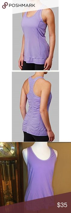 Lululemon Run Energy SL Tank Lululemon run energy SL Racerback tank top. Rouching all in the back. Drawstring on the bottom hem. Size 6. Great condition. Lavender purple tank. lululemon athletica Tops Tank Tops