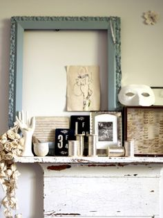 Use an empty frame on a mantle behind other items - lovely!