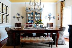 traditional dining room by Corynne Pless; bench adds informality to an otherwise stuffy formal room