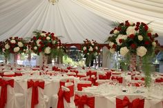 Red roses and white hydrangeas wedding reception centerpieces. With black table clothes and chair covers Red And White Wedding Decorations, Wedding Hall Decorations, Red And White Weddings, Wedding Reception Centerpieces, Wedding Themes, White Hydrangea Centerpieces, White Hydrangeas, Tall Floral Arrangements, Red Wedding Flowers