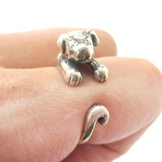 A cute and realistic baby puppy dog animal ring that wraps around your finger in .925 sterling silver! Also available in normal tin alloy in our store if you're not allergic to metal alloys!  Available in US Size 4 to size 8.5!  *** This item ships with tracking! ***  ---  Sizing:   - All ri