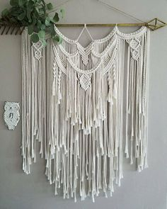 Make a statement in your home with this large and stunning macramé wall hanging. Created from light ivory rope and hung from a gold arrow, this beautiful piece is full of detail and layers. This item is made to order and will vary slightly from the photos above. I do my best to find similar