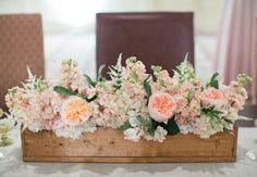 This wooden windowbox of pink peonies makes for a gorgeous centerpiece! Photo: Theo Milo Photography // Featured: The Knot Blog