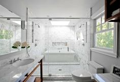 Wet Room? Bathtub inside a shower. I'm puzzled and intrigued all at once.