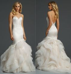 """Antique tulle bridal ball gown with a sheer embroidered """"V"""" neckline and low back, sexy mermaid dress with3/4 length sleeves and open back with a jeweled trim and skirt godets,orivory pearl and crystal encrusted tulle bridal gown with shimmer throughout, if you long to glide down the aisle in a gown fit for a princess, […]"""