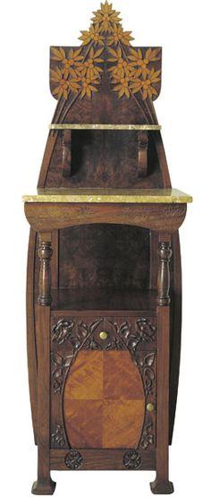 Gaspar Homar i Mesquida (1870-1953) - Bedside Table. Carved Walnut, Burl Veneer with Fruitwood Marquetry Inlays and Marble Top & Shelf. Barcelona, Spain. Circa 1900-1904. 146cm x 51.4cm x 42.5cm.