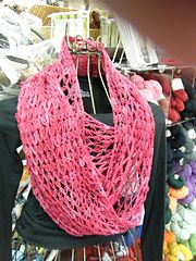 The Love-Me-Knot Cowl is a versatile piece that can be worn draped about the neck once or twice; folded and looped like a regular scarf; opened and worn around the shoulders like a shawl; draped like a hood; the possibilities are endless!