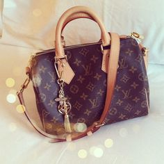 Louis Vuitton Speedy Bandouliere 25 with the monogram canvas..the perfect everyday bag!