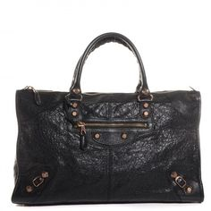 This is an authentic BALENCIAGA Agneau Giant 12 Rose Gold Work in Black. This stylish tote is crafted of distressed and soft agneau lambskin leather.