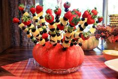 DIY ideas: Pumpkin Fruit Skewer holder. Could also use a different base (ex. watermelon) for different seasons