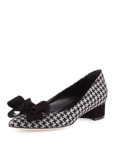 """Manolo Blahnik herringbone fabric pump. 1.3"""" suede block heel. Pointed toe with suede bow. Slip-on style. Leather sole. Smooth outsole. """"Listony"""" is made in Italy."""