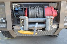 The MXXL 24 AH has a hydraulic winch up front