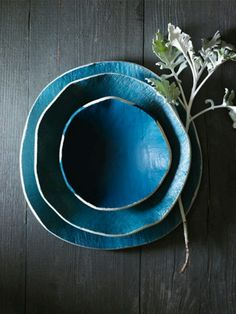 Wabi Sabi may be seen in pottery where the pieces appear rustic and simple-looking, such as Japanese Hagi pottery with shapes that are not quite symmetrical, and colors or textures that appear to emphasize an unrefined or simple style. LOVE.