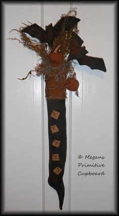 Primitive Grungy Fall Halloween Witch Boot Stocking Door Hanger Doll with Black Bats and Pumpkin Pods handmade by Megans Primitive Cupboard for sale!