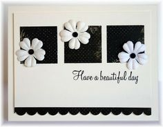 The card - a simple layout with squares of printed paper, some prima flowers and a sentiment.  Colors are vanilla and black.