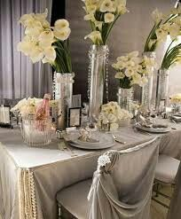 Styling: crystals, cut glass, photo frames. Leaving out the pearls will make it feel less 'wedding.'