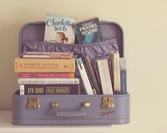 Some of my favorite books!  I also love the vintage suitcase.  My mom used to have a whole set like this one. Vignette idea