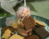 Sugar Faerie eating biscuits inside a glass dome - Mandmade Ooak fairy art doll cookies - more great stuff on Etsy and Alvaro Herranz' website!
