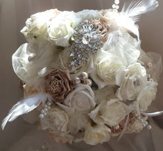 LOOOOVEEE this brooch bouquet with just a few brooches and lots of different fabric flowers pearls feathers and tulle!!!