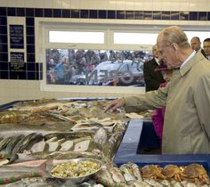 Prince Philip looking at some fish