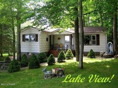 THIS CUTE, 3 BEDROOM, 1 BATH, OVERSIZED GARAGE WELL MAINTAINED LAKEVIEW HOUSE IS SITUATED ON ALMOST ONE ACRE, (3 LOTS) LOCATED DIRECTLY ACROSS THE STREET FROM CRYSTAL LAKE IN A GATED, AMENITY FILLED COMMUNITY IN THE NORTHERN POCONOS. WALK TO YOUR OWN BOATDOCK. DON'T MISS THIS ONE!!! PRICED TO SELL FAST!!!