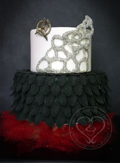 """In honor of the Catching Fire premiere, I made this Mockingjay/dress """"cake"""" (it's fondant and icing and all that, but it's just styrofoam underneath)."""