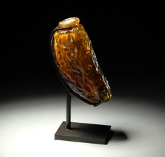 Roman Amber Glass Perfume or Ointment Flask in the form of a date - 100 CE