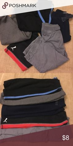 Boys Pants Bundle Five pairs of boys pants. Red/black Puma 24mos, gray Garanimals 24mos, blue Old Navy 18-24mos, gray Garanimals 24mos, black/blue sweats 24mos. Used condition, mild wear, no tears or stains. Many other kids listings available to bundle. Bottoms Sweatpants & Joggers