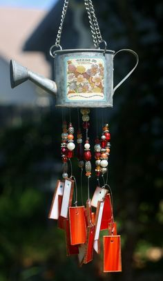Wine Bottle Wind Chime - Snapdragon is made from Stained Glass, Clear Bottle, Up-cycled Mini Watering Can and Beads.  Indoor/Outdoor Use  http://www.idealshedplans.com