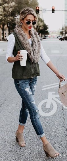Cargo vest with a faux fur lining. Distressed denim paired with booties.