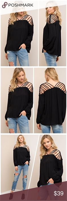 Gorgeous strappy black blouse! Beautiful and flattering- this unique piece is slightly oversized and a must have in any fashionista's closet! Tops