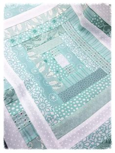"""Holly Hill Quilt shoppe: January 2015. Kate Spain's fabric line """"Solstice"""". Pattern is """"Strippy and Bright"""" by Bonnie Olaveson (Cotton Way)."""
